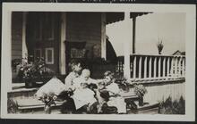 Three Children Sitting on Steps of Porch
