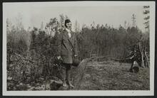 Man Standing on Log