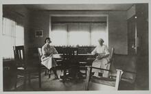 Two Women Seated at Table