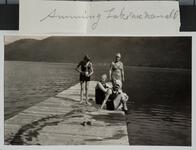 Swimmers on Lake McDonald Dock