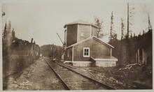 Building by Railroad Track