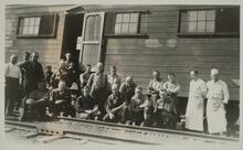Group of Men by Railroad Track