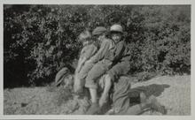 Three Children on Back of Young Boy