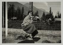 Woman Seated on Log
