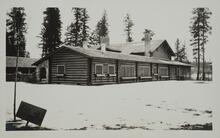 Log House with Snow on the Ground