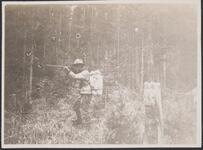 Man in Woods Aiming Gun