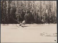 Two Men Fishing on Log