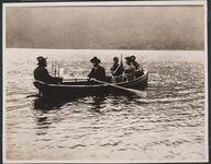 People in Boat on Lake