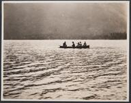 Group of People in Boat on Lake