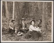Group Seated in Woods