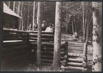 Charles M. Russell, Josephine Trigg, and Nancy C. Russell on Porch at Bull Head Lodge