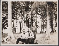 Three Adults and Young Boy in Woods