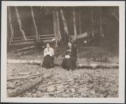 Two Women Seated on Log