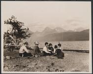 Group Seated on Lake Shore