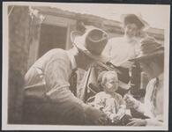 Charles M. Russell and Nancy C. Russell with a Small Child and Woman