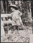 Small Child Holding a Fishing Pole