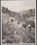 On Horseback with Pack Horse Decending Mountain