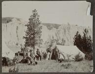 Charels M. Russell with Five Unknown Men at a Camp