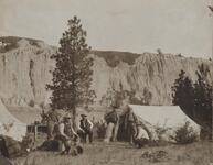 Charles M. Russell and Four Unknown Men by Tent in Canyon