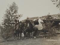 Charles and Nancy Russell with Unknown Man on Horses