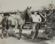Charles M. Russell Standing Next to Horse