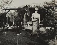 Nancy C. Russell Standing Next to Horse
