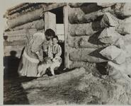 Woman, Child, and Dog at Cabin Door