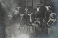 Charles M. Russell and Nine Unknown Men by Campfire