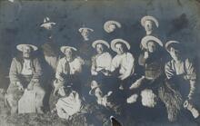 Twelve Men by Campfire