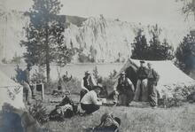 Charles M. Russell with Four Unknown Men by Tent in Canyon