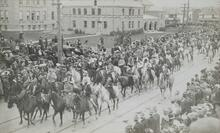 Postcard of Mounted People in Street