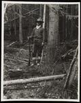 Man in Woods Holding Gun