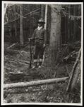 Man in Woods Holding Gun