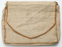 Large linen bag with rust-colored, possible silk trim