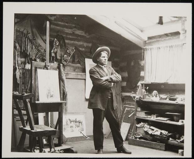 Charles M. Russell in his studio with art (TU2009.39.256.16a)